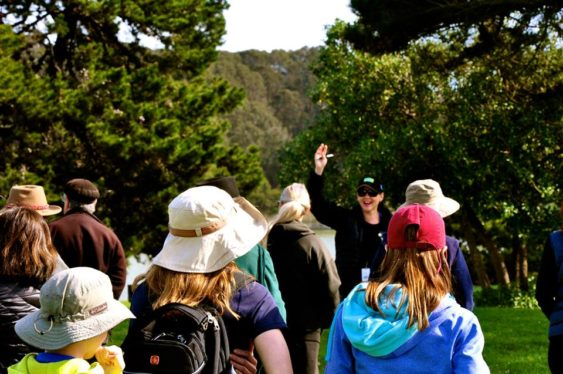 A group of hikers listening to a guide 563x374